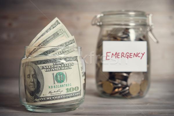 Financiële nood label dollar munten glas Stockfoto © szefei