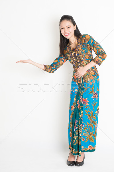 Asian woman hand holding something Stock photo © szefei