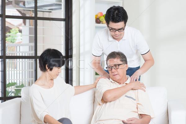 Kıdemli adam omuz ağrısı Asya yaşlı adam oturma Stok fotoğraf © szefei