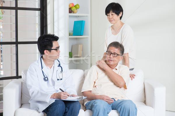 Doctor with senior patient Stock photo © szefei