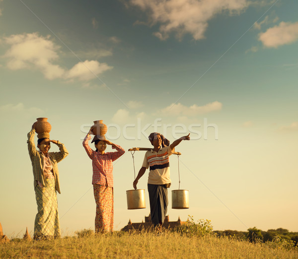 Group Asian Burmese traditional farmers in sunset Stock photo © szefei