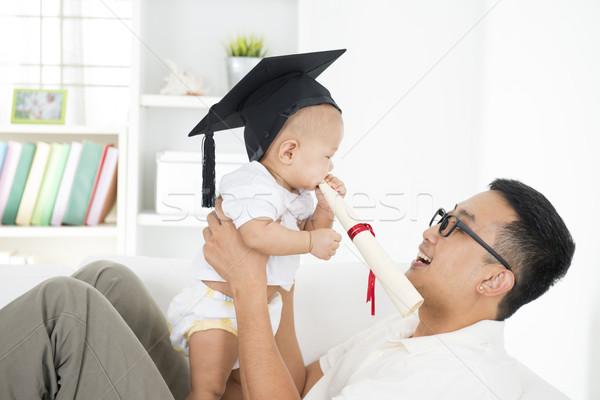 Gyermek korai oktatás baba érettségi sapka tart Stock fotó © szefei