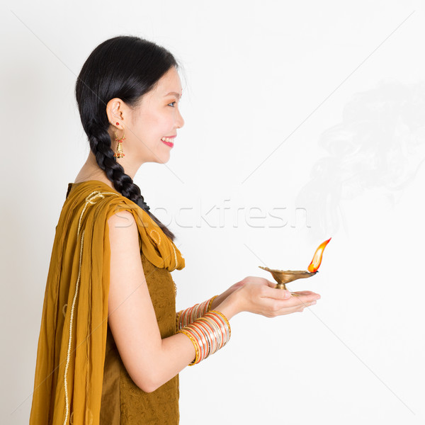 Woman holding Diwali diya light Stock photo © szefei