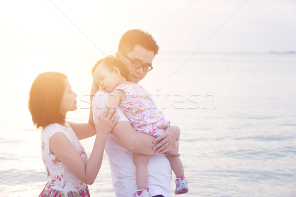 Family enjoying summer holiday at coastline Stock photo © szefei