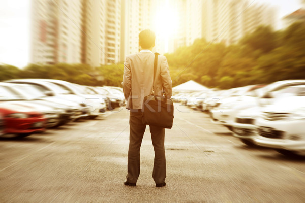 Businessman at open car park. Stock photo © szefei