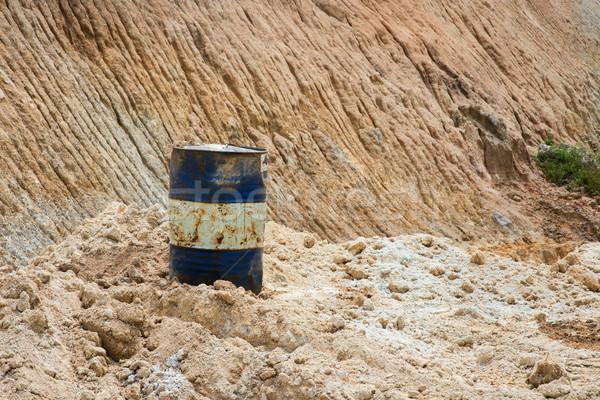 Oil drum on sand mines Stock photo © szefei