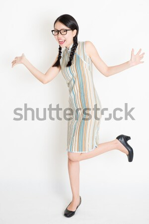 Asian Chinese girl pointing and looking on blank copy space Stock photo © szefei