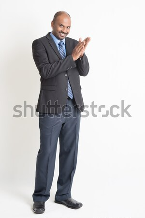 Indian businesspeople clapping hands Stock photo © szefei