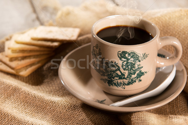 Traditional Malaysian Chinese coffee and soda crackers Stock photo © szefei