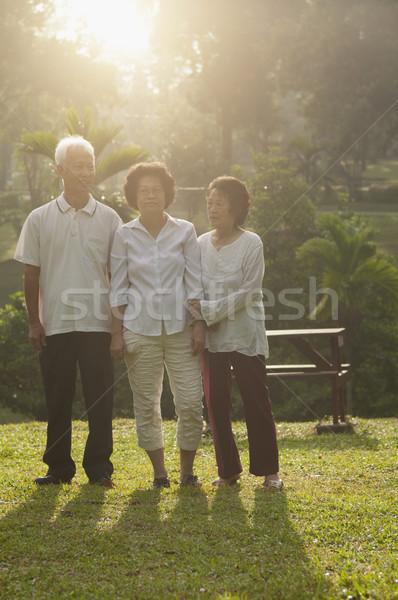 Group of Asian seniors walking at outdoor park Stock photo © szefei