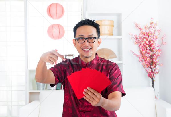 Chinese man and Ang Pow Stock photo © szefei