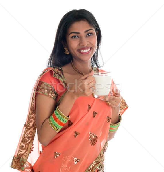 Indian woman drinking milk Stock photo © szefei