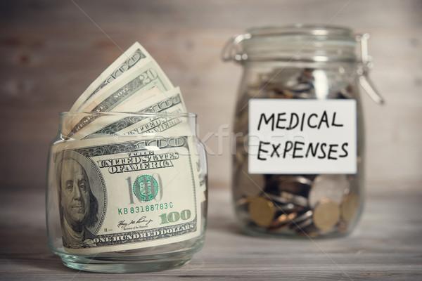 Dólares moedas jarra médico despesas etiqueta Foto stock © szefei