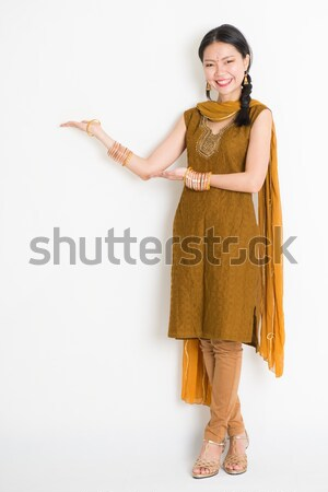 Excited Indian Chinese woman arms raised Stock photo © szefei