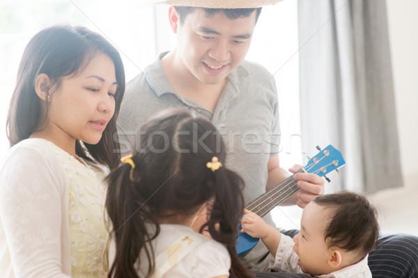 Family playing ukulele  Stock photo © szefei