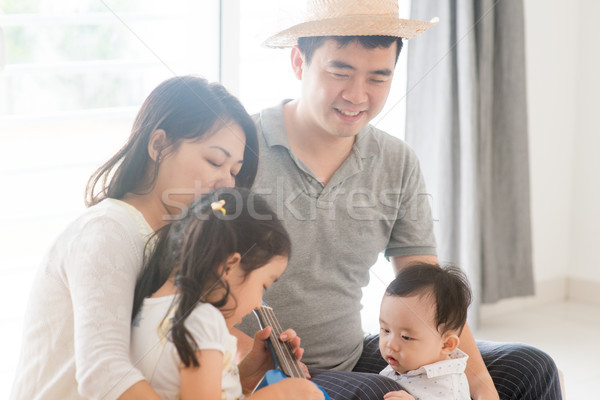 Family playing music instrument  Stock photo © szefei