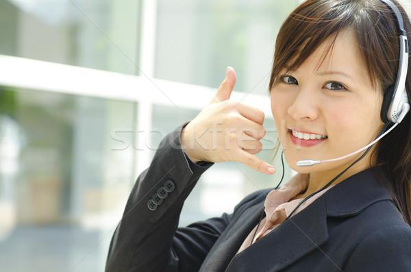 Amigável cliente representante fone mulher Foto stock © szefei