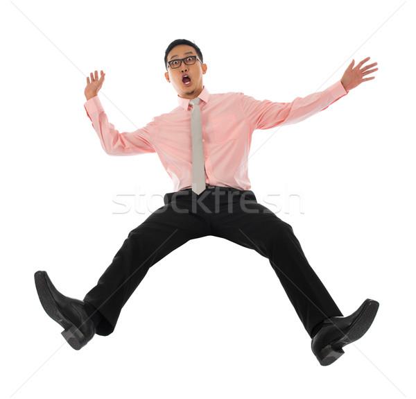 ázsiai üzletember zuhan visszafelé egészalakos megrémült Stock fotó © szefei