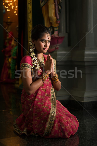 Indian woman praying Stock photo © szefei