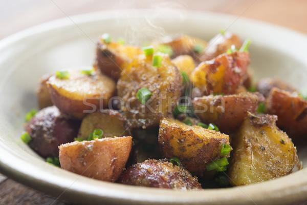 Baked baby potatoes Stock photo © szefei