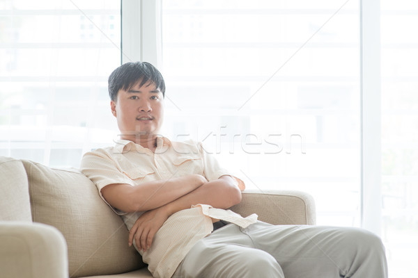 Mature man at home Stock photo © szefei