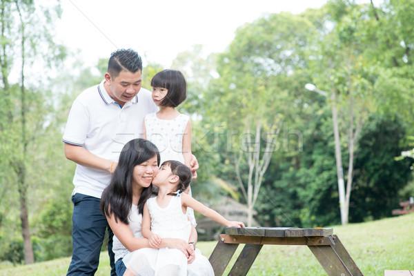 Boldog ázsiai családi portré üres asztal űr Stock fotó © szefei