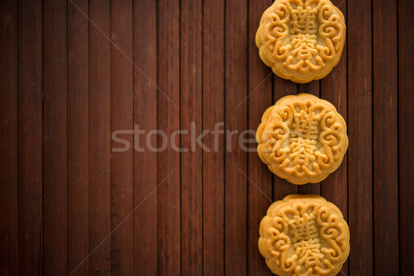 Moon cakes on bamboo mat dark light with copy space  Stock photo © szefei