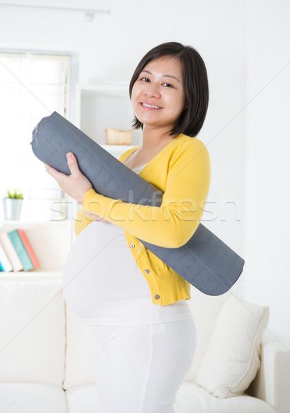 Asya hamile kadın yoga mat yoga ev Stok fotoğraf © szefei