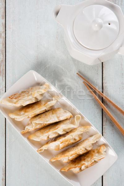 Top view Asian food pan fried dumplings Stock photo © szefei
