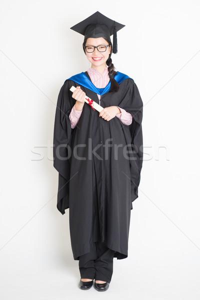 Teljes alakos egyetemi hallgató boldog érettségi talár sapka Stock fotó © szefei