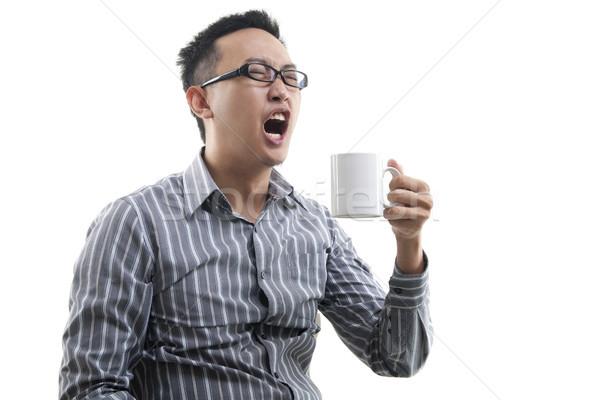Yawning Asian male  Stock photo © szefei