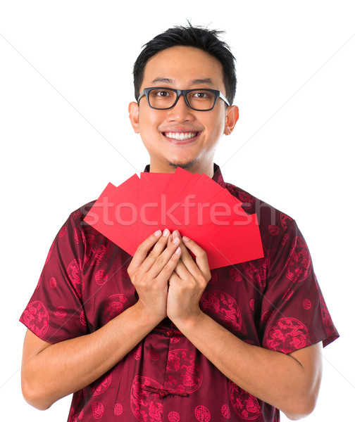 Happy Southeast Asian Chinese male Stock photo © szefei