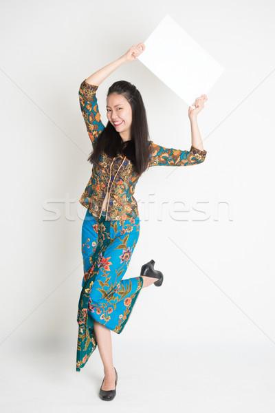 Asian girl showing white card Stock photo © szefei