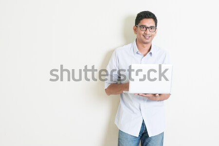 Casual business Indian man using laptop Stock photo © szefei