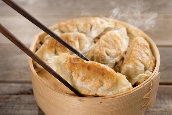 Popular Chinese gourmet pan fried dumplings Stock photo © szefei