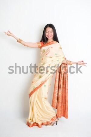Female in Indian sari dress dancing Stock photo © szefei
