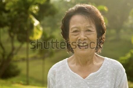 ázsiai idős nő 80-as évek park reggel Stock fotó © szefei