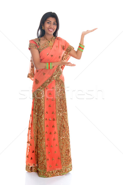 Indian woman showing empty space Stock photo © szefei