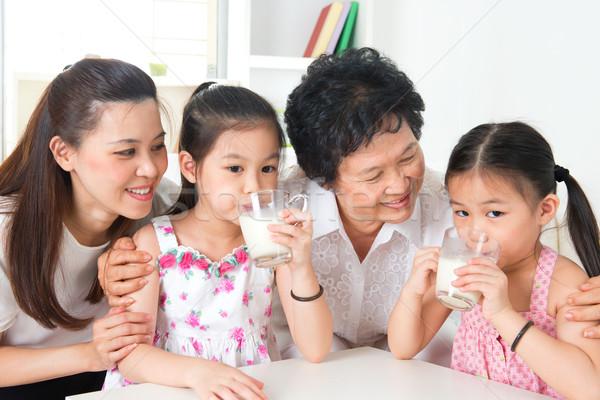 Happy multi generations Asian family at home Stock photo © szefei