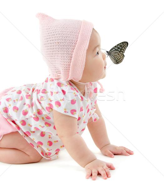 Butterfly on nose Stock photo © szefei