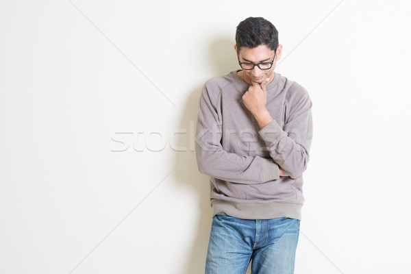 Thoughtful casual Indian male  Stock photo © szefei