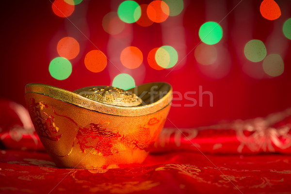 Chinese New Year decorations gold ingot on red background Stock photo © szefei