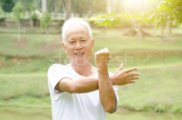 Old people stretching outdoor  Stock photo © szefei