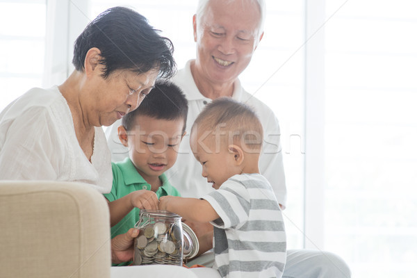 Family saving money concept Stock photo © szefei