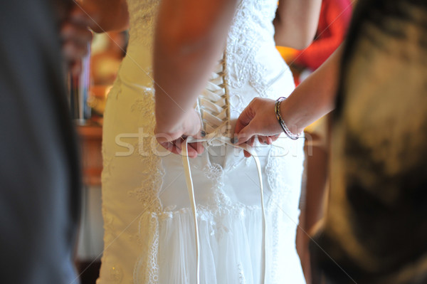 Stock photo: Wedding gown being tied up