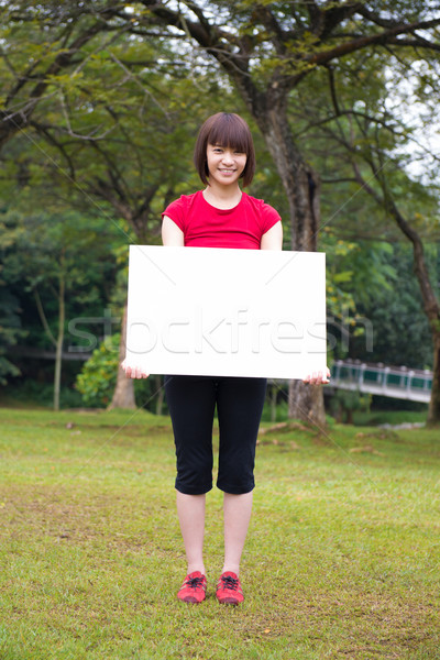 Asian girl holding a placard outdoor Stock photo © szefei