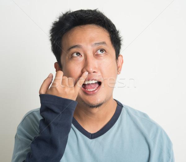 Asiático homem nariz nojento olhos Foto stock © szefei