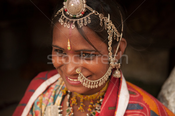 Traditional Indian female in sari smiling Stock photo © szefei