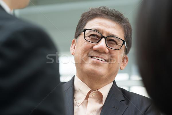シニア ビジネスマン アジア ビジネスチーム 会議 男性 ストックフォト © szefei