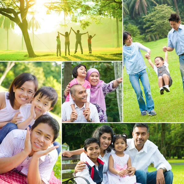 Mixed races family having fun at outdoor  Stock photo © szefei